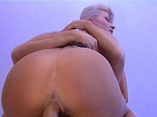 Chesty blond bitch jumping on cock