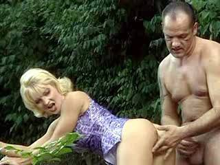 Mature blonde fucks in doggy style in exotic nature