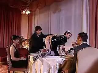 Naughty housemaid amusing depraved guests at dinner
