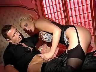 Gorgeous blond lady deep sucks stiff dick on wide bed