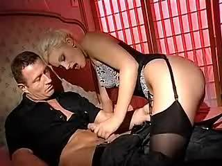 Charming blonde in stockings gets fucked on wide bed