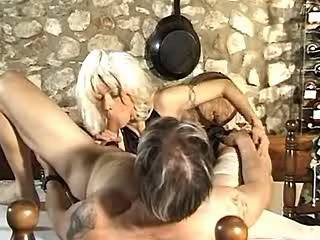 Blond slut in stockings sucks stiff dick on kitchen
