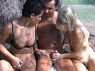 Two luxurious sluts fucking with lewd dude in nature