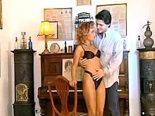 Charming blond beauty having oral fun by white piano