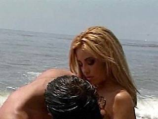 Romantic blowjob on the beach with hot water nymph
