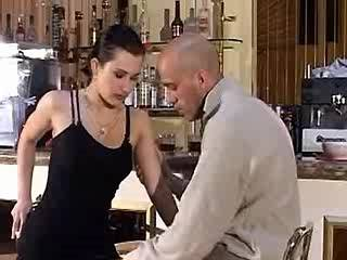 Brunette in black stockings gets fucked in bar
