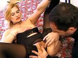 Sexy blond in black stockings gets pounded hard in bed
