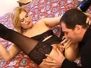 Mature blonde in black stockings sucks strong cock