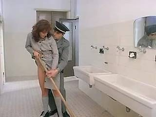 Guard makes use of sexy woman prisoner in lavatory