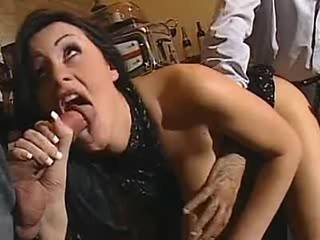 Wild gorgeous brunette loves threesome sex on table