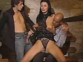 Horny attractive vixen in wild orgy with two dudes