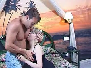 Vigorous hunk fucking with oversexed blonde on bed