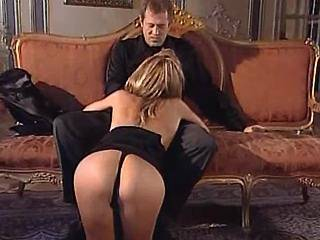 Skillful call girl sucking hunk on sofa in mansion