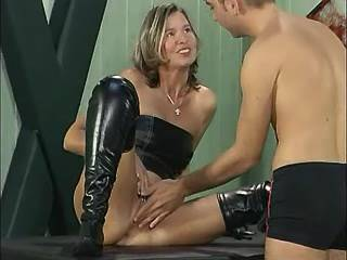 Mature lady in bright boots fucking with young boy