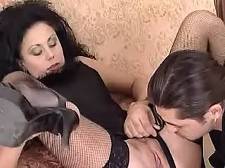 Dude fucks with cute brunette in stockings on sofa